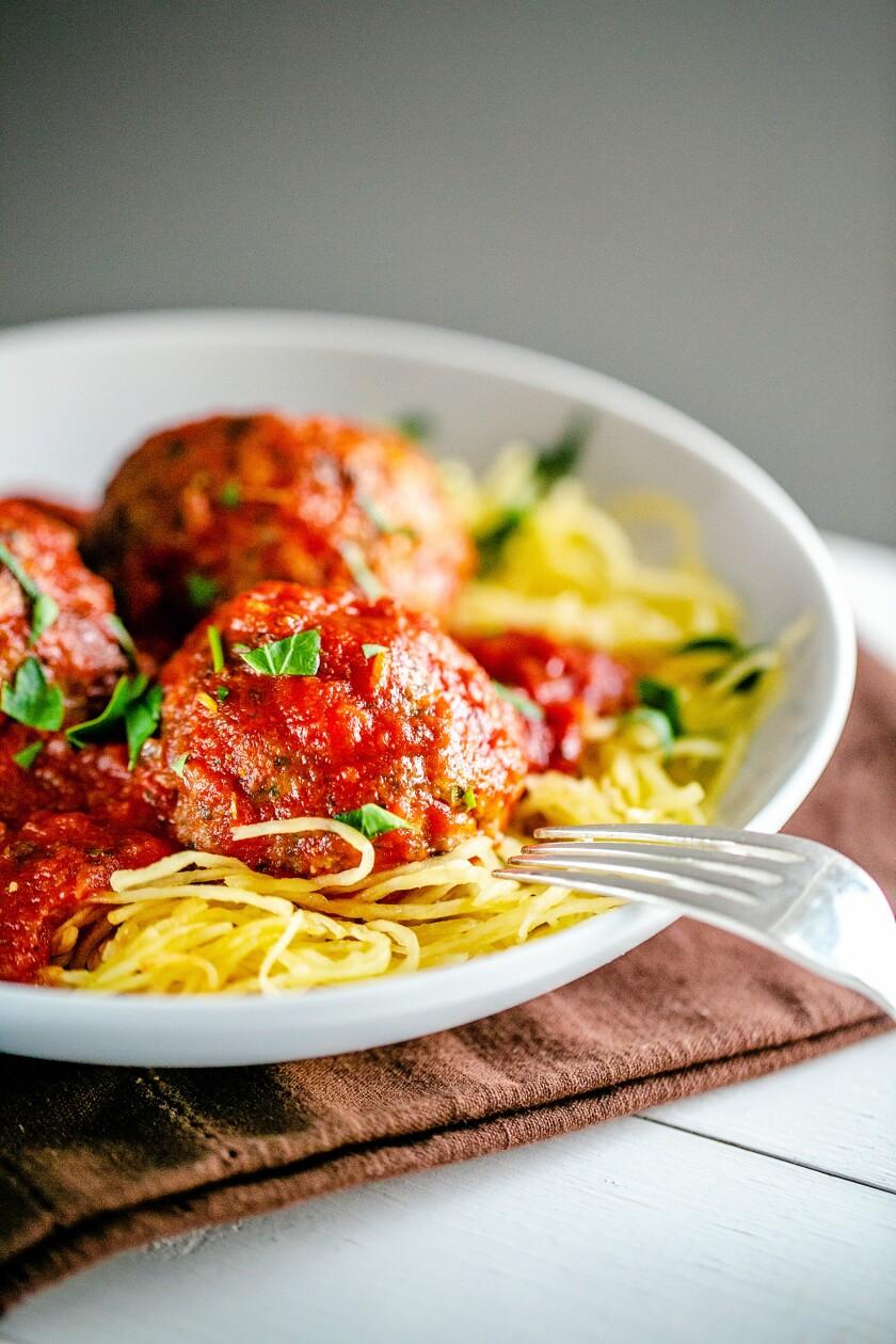 Meatballs and sauce over spaghetti squash.