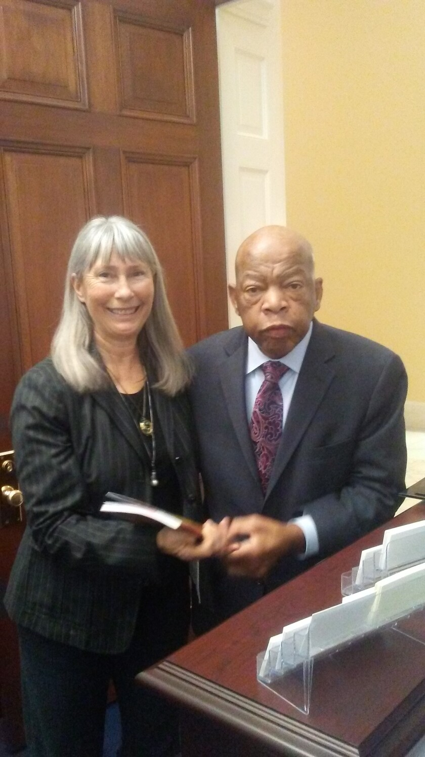 Jo Thompson of Pacific Beach meets Rep. John Lewis (D-Ga.) in January 2019.