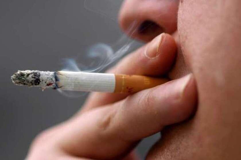 A person smokes a cigarette.