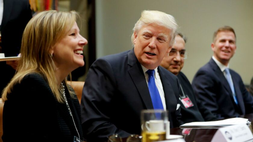 President Trump meets with General Motors CEO Mary Barra, left, and other auto executives at the White House.