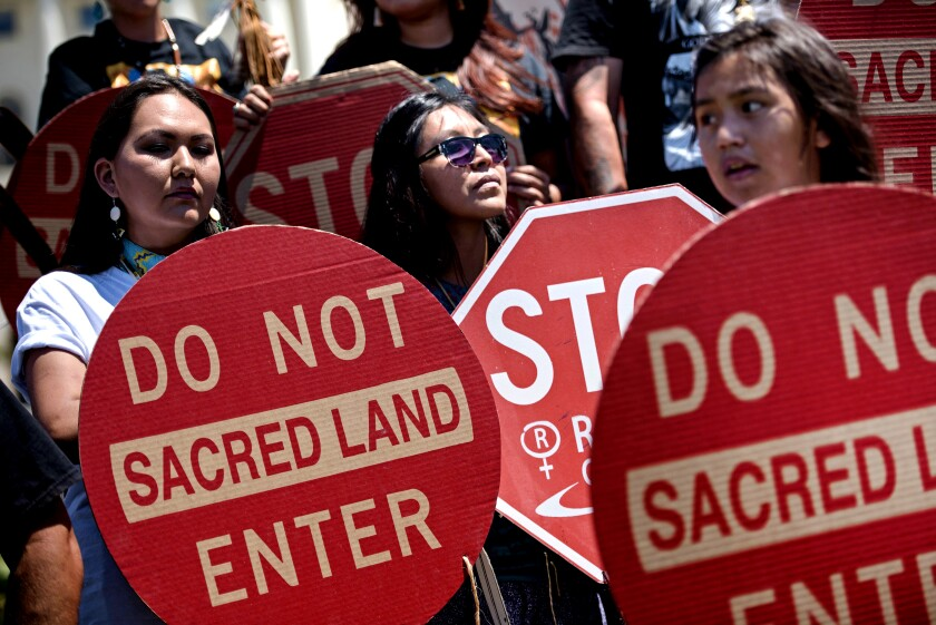 Members of the San Carlos Apache Nation gather to protest on Capitol Hill in 2015.
