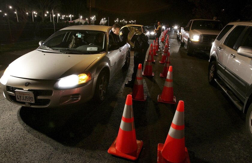 San Bruno police officers stop cars at a DUI checkpoint. State officials are proposing a new test to determine when motorists are driving under the influence of marijuana and other drugs.