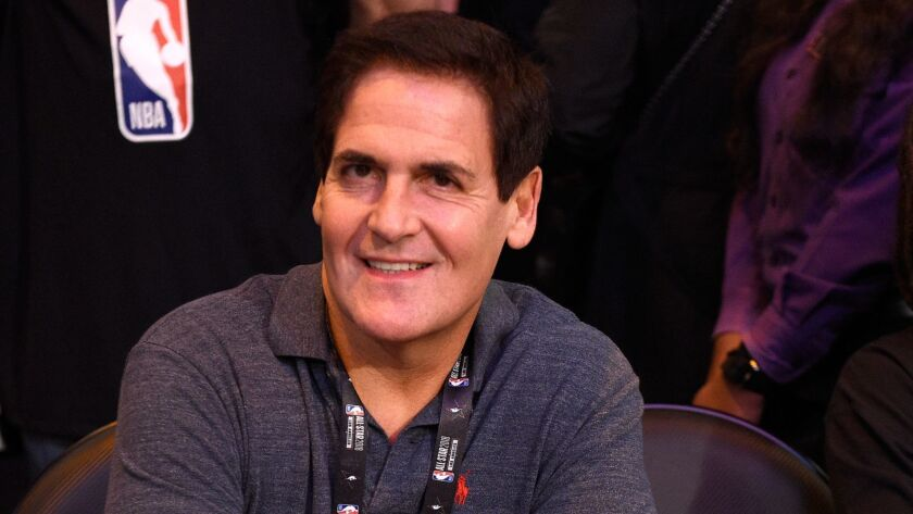 Mavericks owner Mark Cuban watches the three-point shooting contest during 2018 All-Star weekend at Staples Center in February.