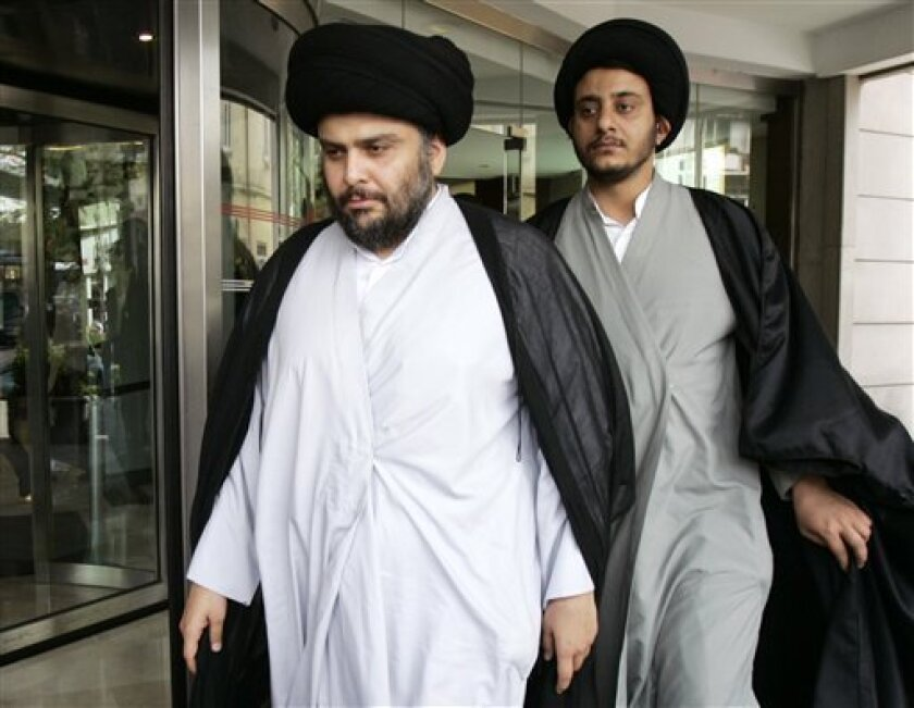 "Iraqi Shiite cleric Muqtada al-Sadr is followed by an advisor as he leaves his hotel in Istanbul, Turkey, Saturday, May 2, 2009. Al-Sadr held talks with Turkey's president Abdullah Gul and prime minister Tayyip Erdogan Friday. No statement was made after the separate talks but a government official said earlier that al-Sadr was scheduled to hold ""consultations on the political process in Iraq."" (AP Photo/Ibrahim Usta)"