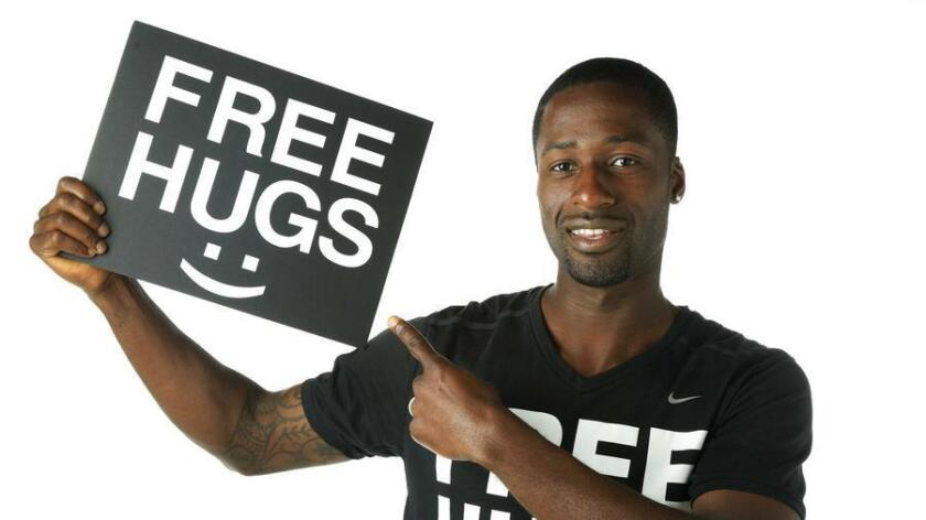 "Ken Nwadike is the creator of the Free Hugs Project, which was started to ""spread love, inspire change, and raise awareness of social issues."" His video of taking his project to a Trump rally and a Bernie Sanders rally, and filming the reactions from both groups, went viral with more than 100 million views. (Howard Lipin)"
