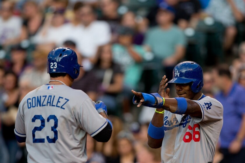 Dodgers first baseman Adrian Gonzalez, left, and right fielder Yasiel Puig are among five players who are eligible for the final roster spot on the National League's All-Star team.