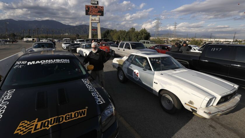 IRWINDALE, CALIF. - APR. 19, 2018. Drivers line up to race at the Irwindale Speedway drag strip i