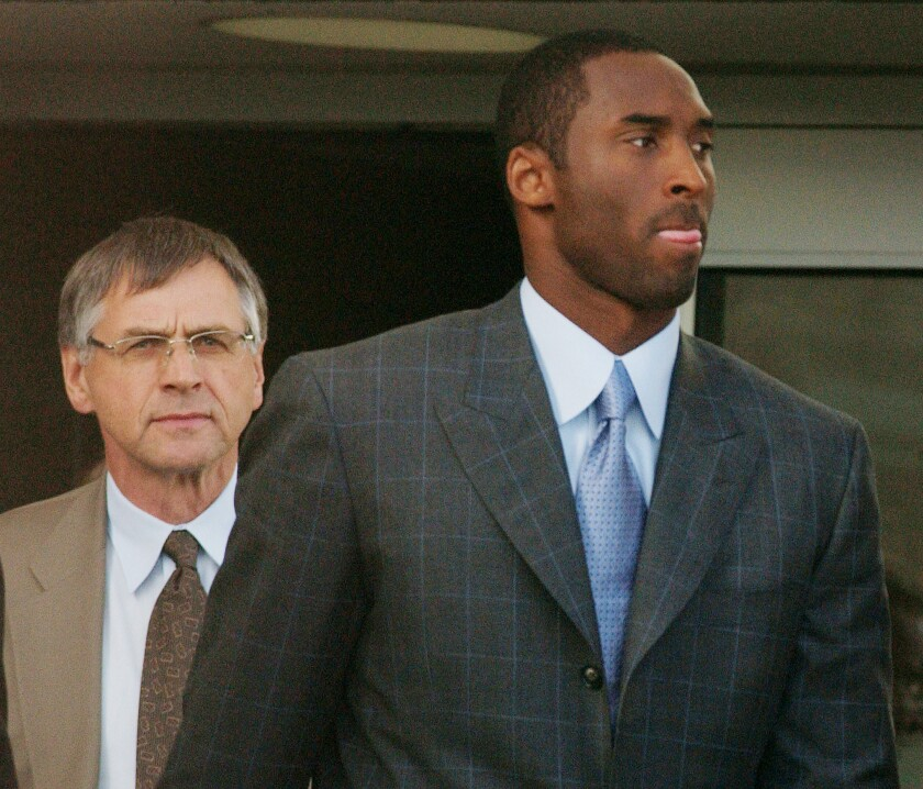 Kobe Bryant and attorney Hal Haddon leave the Eagle County (Colo.) Justice Center after the third day of jury selection for the trial on sexual assault charges.