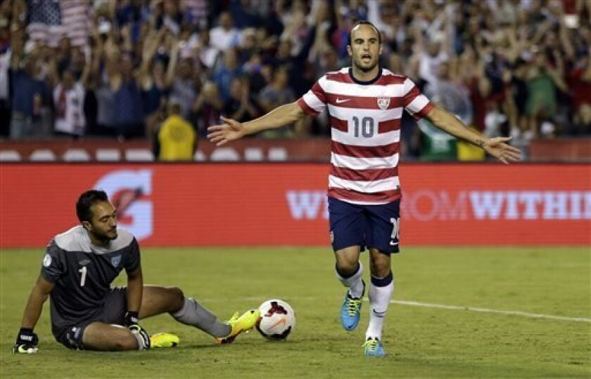 The United States' Landon Donovan, right, reacts after scoring on a penalty kick as Guatemala's goalkeeper Ricardo Jerez gets up at left in the second half during an international friendly soccer match Friday, July 5, 2013, in San Diego. (AP Photo/Gregory Bull)