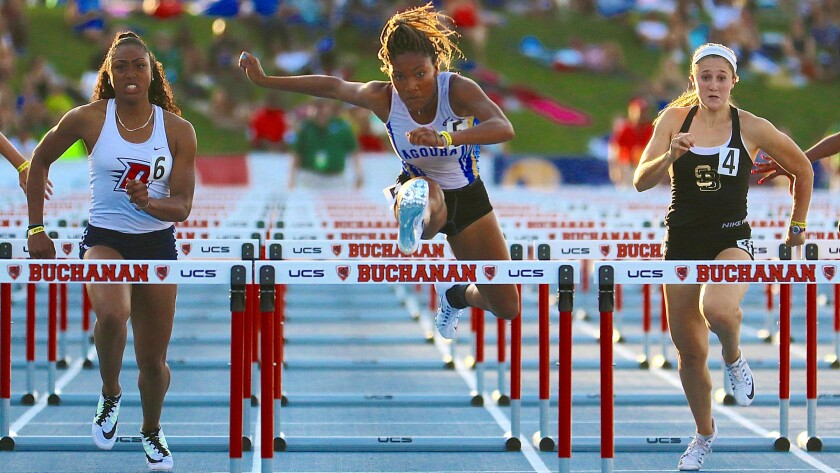 Agoura's Tara Davis (center) repeated as hurdles champion at the state meet.