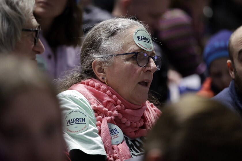 A woman caucusing for Elizabeth Warren