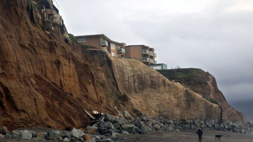 On Pacifica Esplanade Dog Beach in January, the remains of an apartment building that fell from the cliffs can be seen along with one still standing. Pacifica, just south of San Francisco, is ground zero for the issue of coastal erosion.