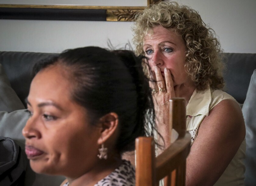 """In this Wednesday, Aug. 21, 2019 photo, Vivien Tartter, right, listens as Guatemalan immigrant Rosayra Pablo Cruz speaks during an interview, in New York. Tartter opened the doors of her Manhattan apartment to Cruz and her sons who had been separated at a detention center in Colorado, reunited in New York and had no place to stay. """"I wanted to help and I knew I could do this,"""" said the divorced empty-nester, who has housed them for a year. (AP Photo/Bebeto Matthews)"""