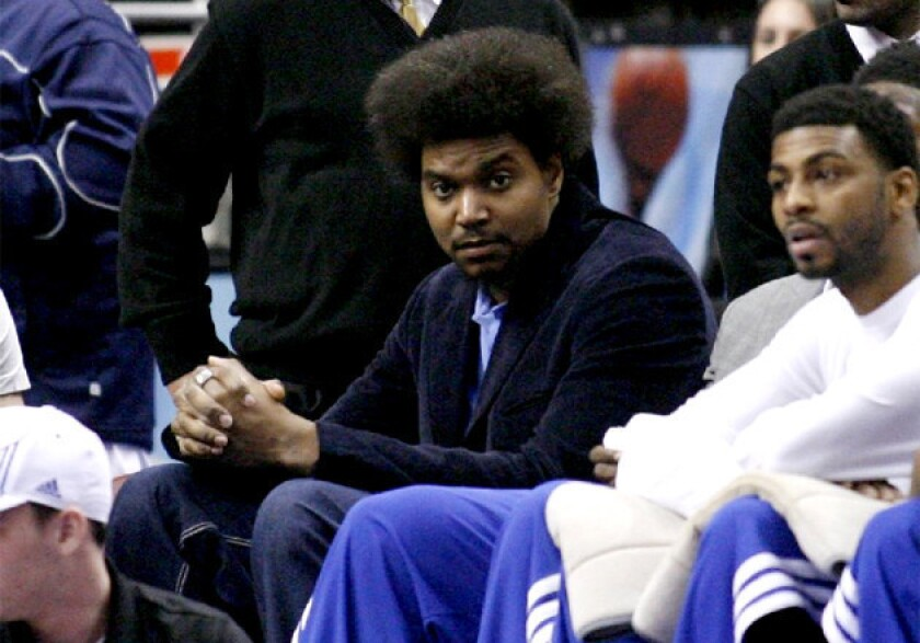 Sixers center Andrew Bynum sits on the bench as his team plays against the Golden State Warriors.