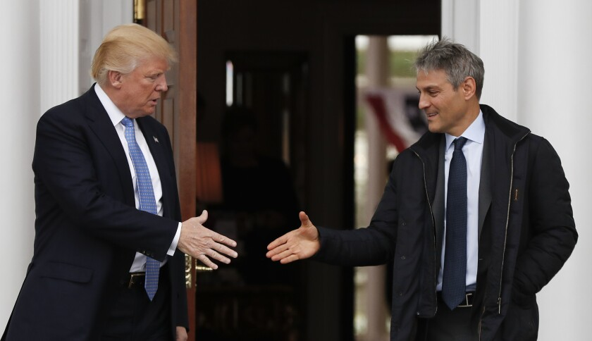 President-elect Donald Trump, left, shakes hands with Ari Emanuel as he leaves the Trump National Golf Club Bedminster clubhouse on Nov. 20, 2016, in Bedminster, N.J.