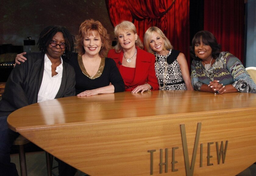 """Whoopi Goldberg, Joy Behar, Barbara Walters, Elizabeth Hasselbeck and Sherri Shepherd pose on the set of the ABC daytime talk show """"The View """" as they launch their 14th season in New York. Behar is leaving the show at the end of the current season in August 2013."""