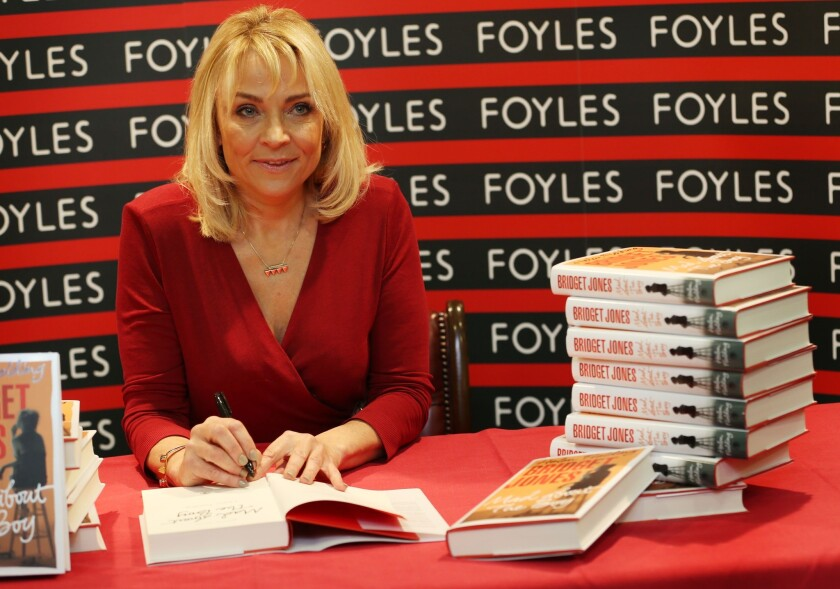 """Author Helen Fielding poses for photographs before signing her latest Bridget Jones book """"Mad about The Boy"""" at Foyles bookshop in London, England."""