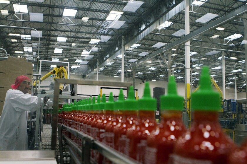 Manuel Benitez works in the packaging area at Huy Fong Foods' Sriracha factory in Irwindale.