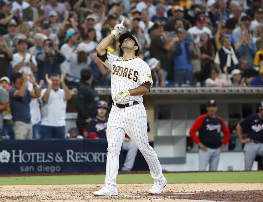 The Padres' Daniel Camarena points skyward after hitting a grand slam