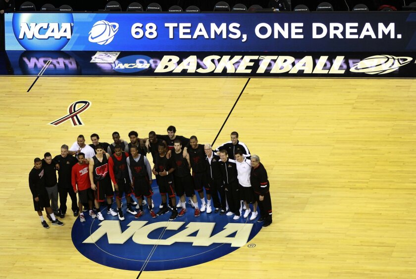 The Aztecs took some time out of practice to shoot a group photo.