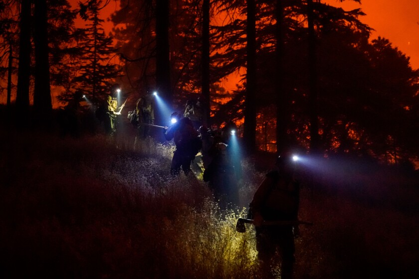 The Laguna Hotshots crew battles the Creek fire as it approaches the Edison Big Creek Hydroelectric Power Station in Southern California