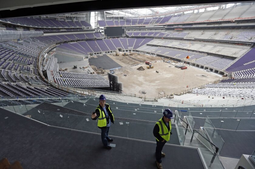 A media member takes a selfie during a tour, Tuesday, Feb. 16, 2016, of the new U.S. Bank stadium in Minneapolis which will be home to the Minnesota Vikings NFL football team.  (AP Photo/Jim Mone)