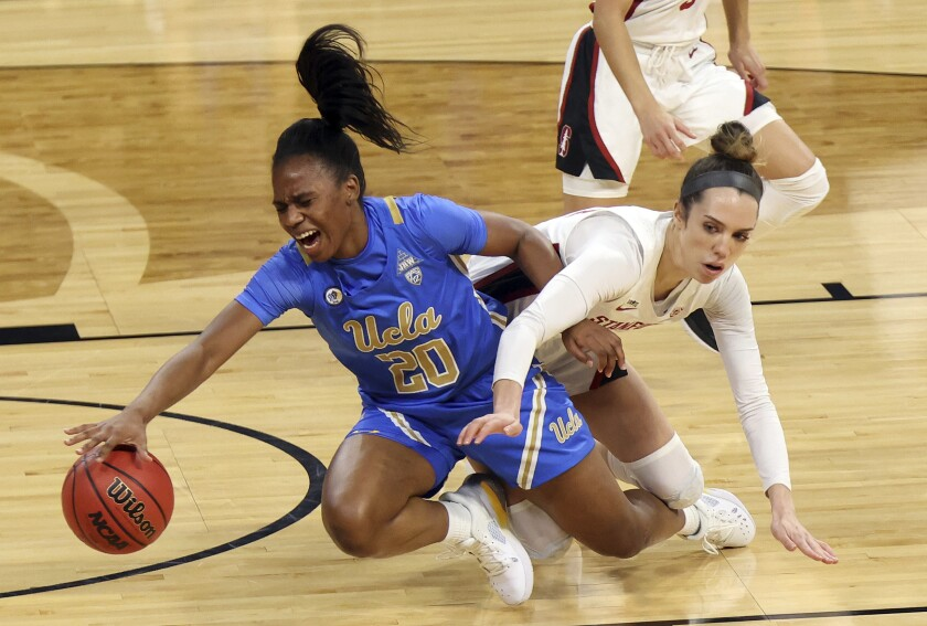 UCLA's Charisma Osborne, left, and Stanford's Lacie Hull battle for the ball during the Bruins' loss Sunday.