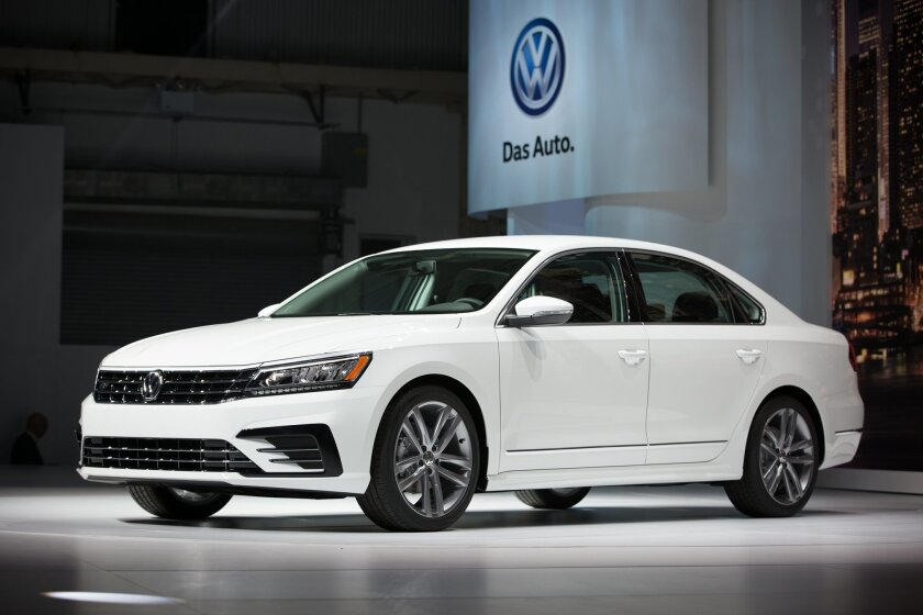 FILE - In this Sept. 21, 2015 file photo, the Volkswagen Passat is displayed during a reveal event at the Brooklyn Navy Yard in New York.  Volkswagen is recalling nearly 92,000 cars in the U.S. to fix mechanical problems that can knock out the power-assisted brakes, Wednesday, Oct. 4, 2015. The rec