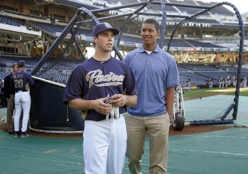 Two of the Padres' top 2011 draft picks, catcher Austin Hedges (left) and pitcher Joe Ross, at Petco Park after Hedges took batting practice before a game.
