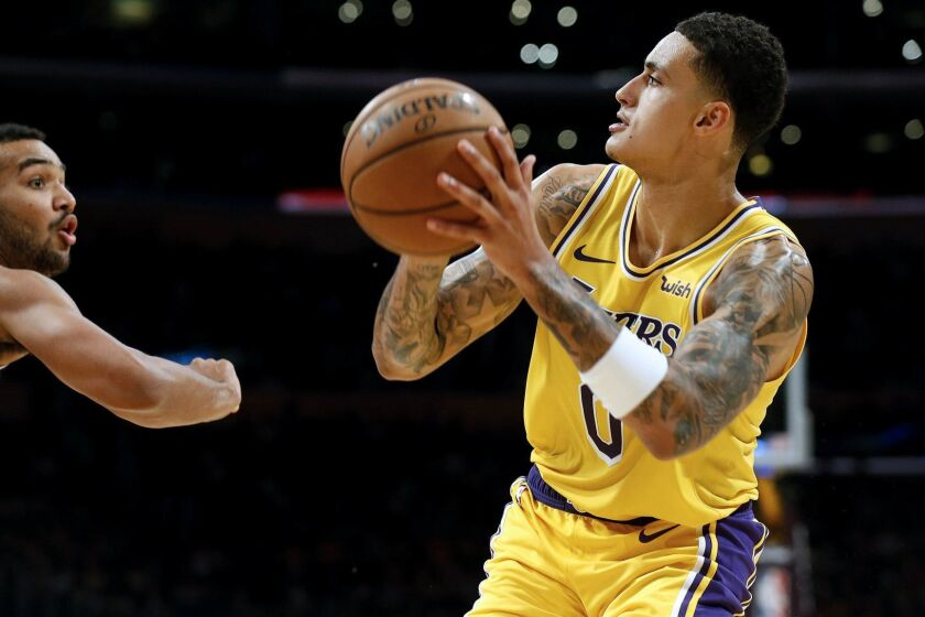 Kyle Kuzma prepares to take a shot against the Nuggets during a game last season.