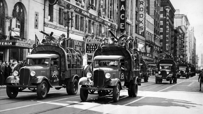 Nov. 11, 1938: Trucks from the 160th Infrantry, California National Guard, cruise down Broadway duri