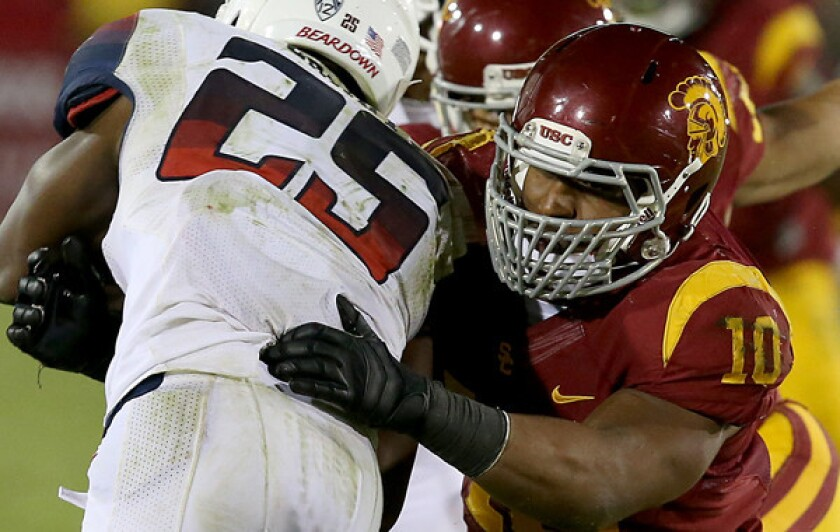 Hayes Pullard, a USC captain in 2013 and 2014, has been hired as a defensive analyst for the Trojans.