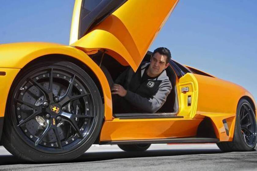Guy Atherton, domestic sales manager for HRE Performance Wheels, sits in a Lamborghini with custom wheels.