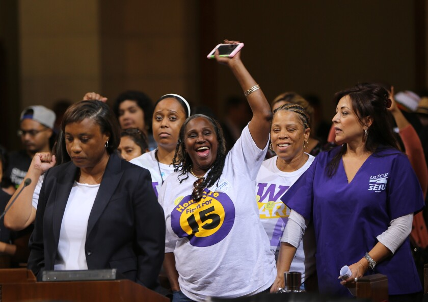 Laphonza Butler, President of SEIU ULTCW, the United Long Term Care Workers' Union, far left, joins workers demanding the Los Angeles City Council to vote to raise the minimum wage on May 19.