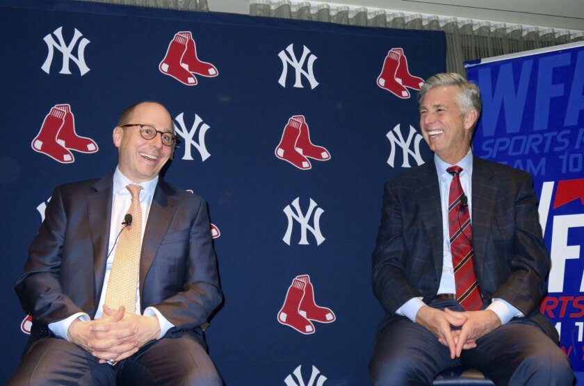 In a photo provided by the New York Yankees, New York Yankees general manager Brian Cashman, left, and Boston Red Sox president of baseball operations Dave Dombrowski appear at a fundraiser Thursday, Feb. 11, 2016, in New York. Dombrowski doesn't expect to be making a lot of trades with Cashman. Du
