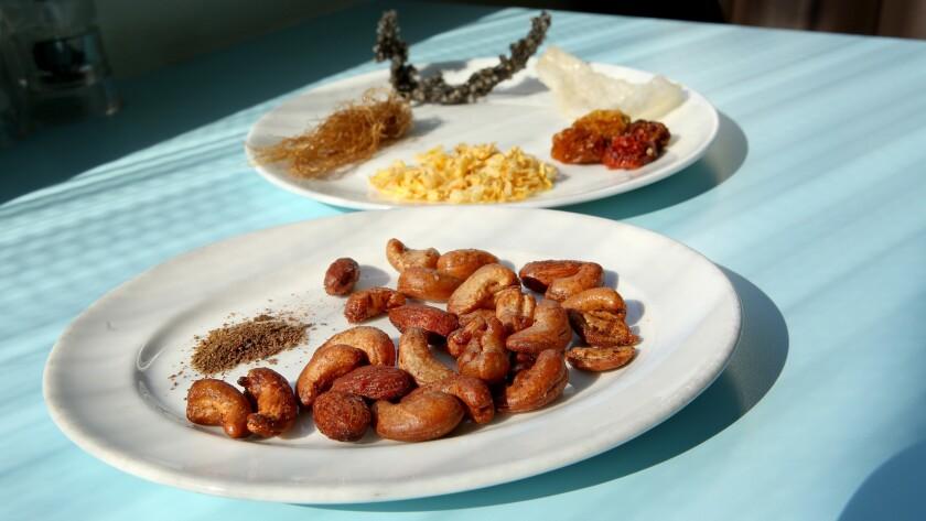 Kimchi Cashews and Almonds, Kimchi powder, corn silk, Tapioca squid ink, puffed onion chip, cherry tomatoes and dry corn kernels.