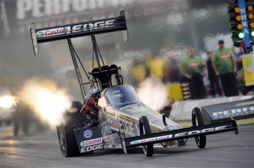 In this photo submitted by the NHRA, Top Fuel rookie Brittany Force powers to the No. 1 qualifying position after the first day of qualifying during the Chevrolet Performance U.S. Nationals auto race, Friday, Aug. 30, 2013, in Indianapolis. Force has yet to secure a No. 1 qualifying position this s