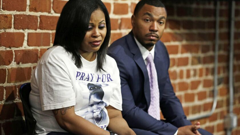 FILE - In this Oct. 3, 2014 file photo, Nailah Winkfield, left, and Omari Sealey, right, the mother