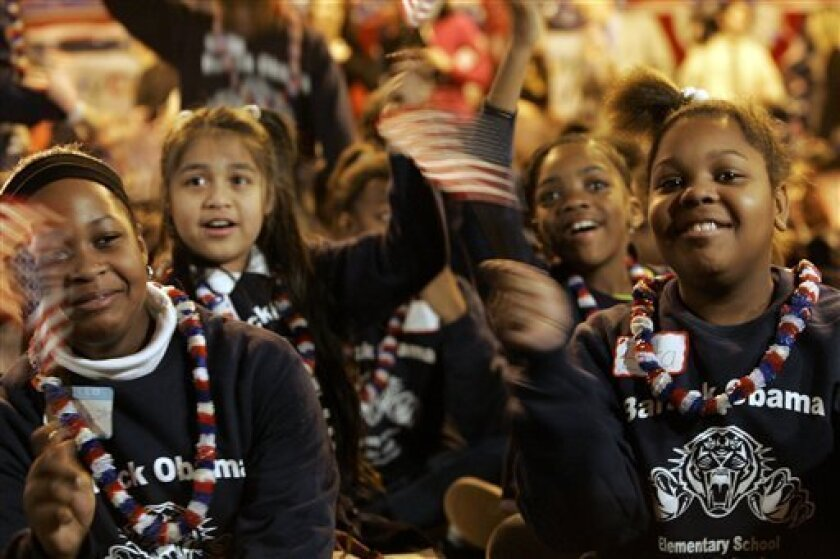 Emily Thomas, left, 9, Wendy Lopez, second from left, 10, Tiara Henry, second from right, 10. and Esta Thomas, 10, students at Barack Obama Elementary School, cheer as they watch television during the inauguration ceremony for President Barack Obama, Tuesday, Jan. 20, 2009 in Hempstead, N.Y.  (AP P