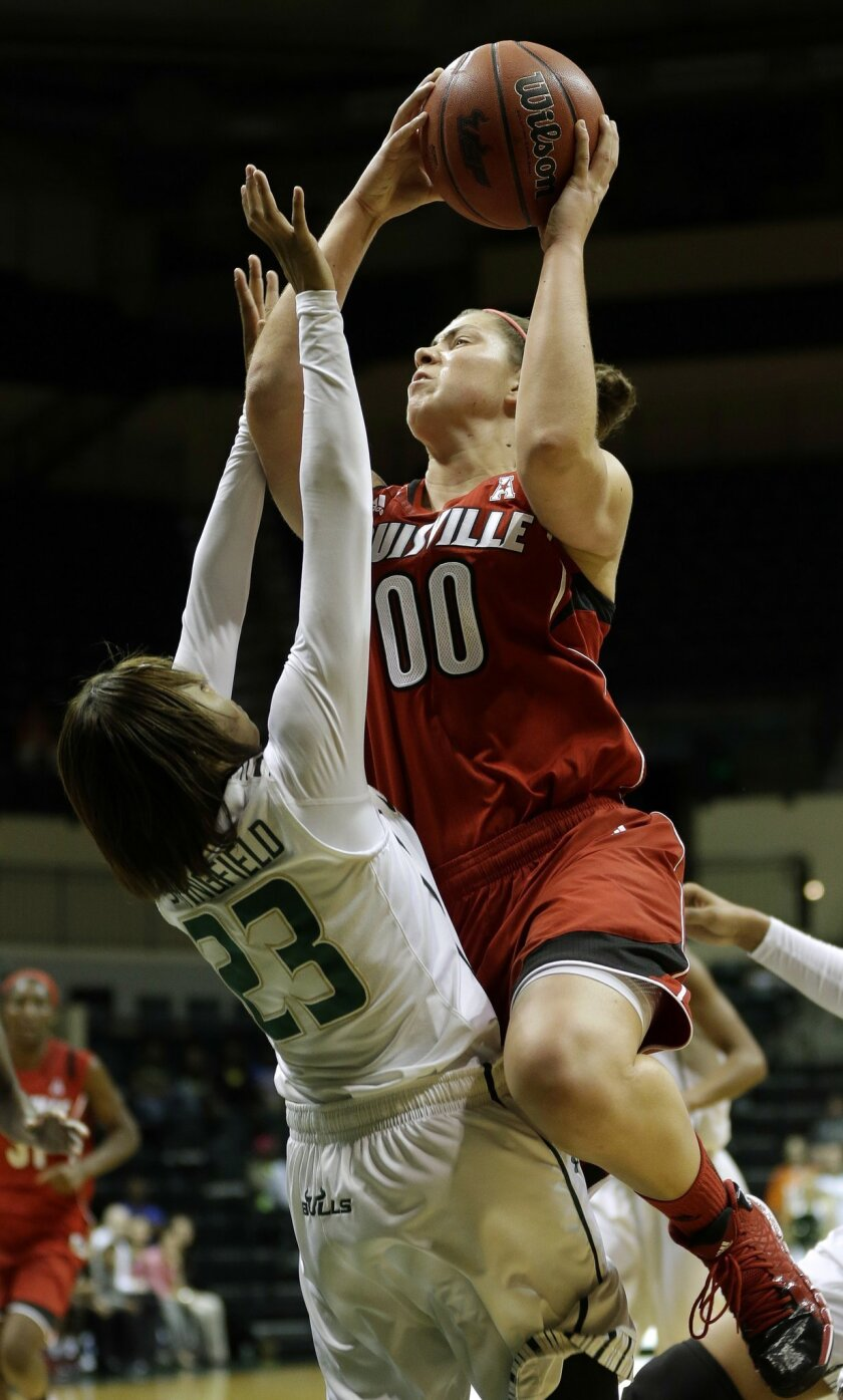 Louisville forward Sara Hammond (00) goes over South Florida guard Shalethia Stringfield (23) during the first half of an NCAA college basketball game on Sunday, Jan. 12, 2014, in Tampa, Fla. (AP Photo/Chris O'Meara)
