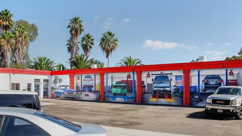 WOW Auto Care owner David Pike commissioned this mural on the side of his Poway Road business.
