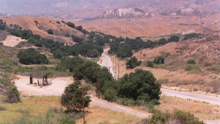 The L.A. County Board of Supervisors on Tuesday approved the first two subdivisions of the long-delayed Newhall Ranch development. Above, an area of the Santa Clarita Valley where the development is planned as it appeared in 1994.