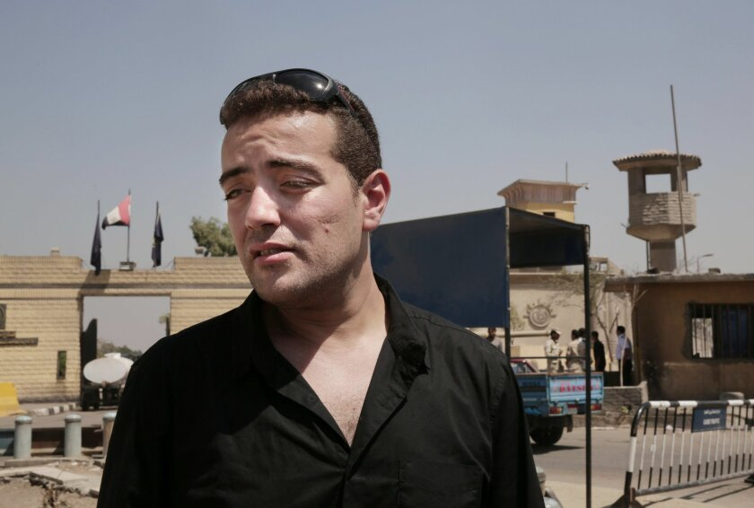 Egyptian Al-Jazeera English journalist Baher Mohammed speaks to media outside Tora prison, in Cairo, Egypt, Thursday, July 30, 2015. Egyptian judicial officials say a Cairo court has postponed the verdict in the retrial of three Al-Jazeera English reporters until Aug. 2. (AP Photo/Nariman El-Mofty)