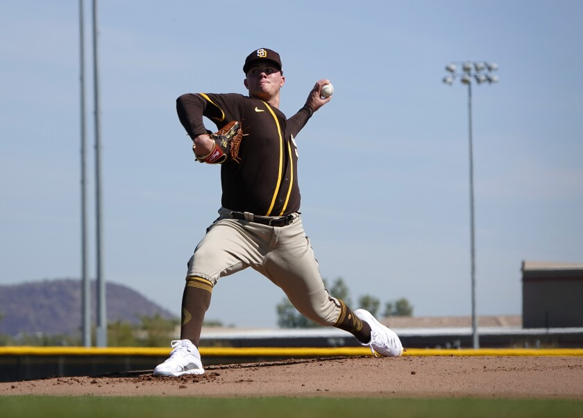Adrian Morejon throws during a spring training workout on Tuesday.