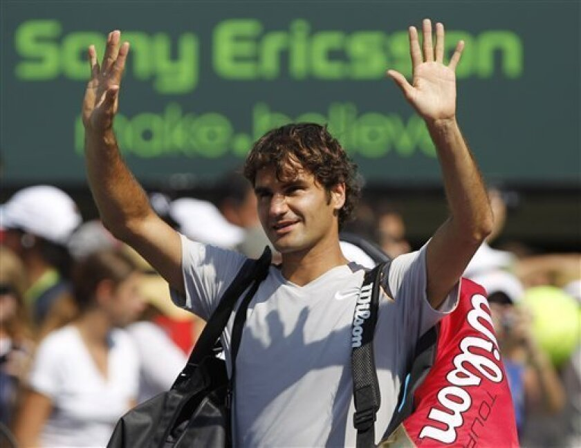 Roger Federer, of Switzerland, acknowledeges the fans as he prepares to leave after his his win against Gilles Simon who retired at the Sony Ericsson Open tennis tournament in Key Biscayne, Fla., Thursday, March 31, 2011. (AP Photo/Alan Diaz)