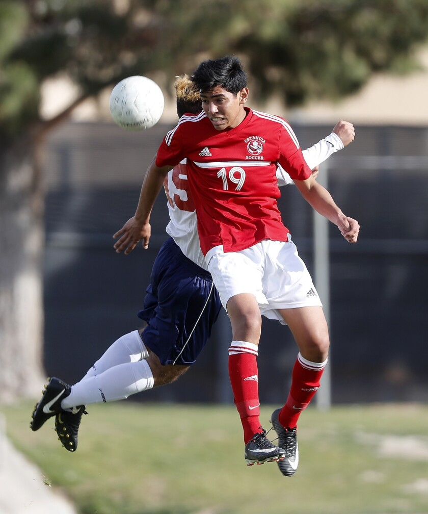 Estancia High's Miguel Pena heads the ball during the first half against La Quinta in the second rou