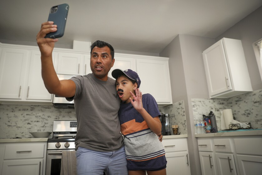 Vicente Avila, 46, known on TikTok as Vinny the Twister, with his 12-year-old daughter, Monse.