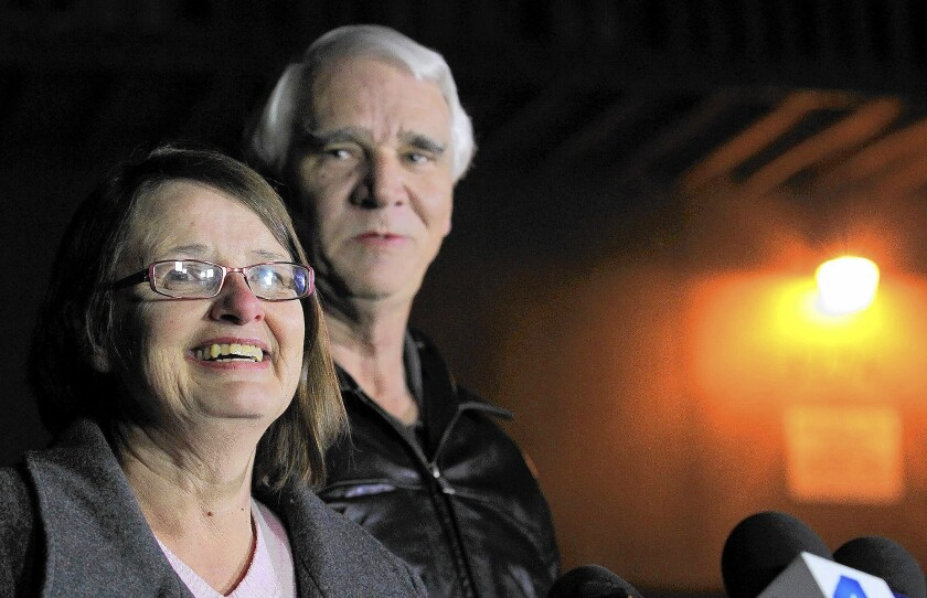Jim Reynolds, 66, right, and his wife, Karen Reynolds, 57, who escaped after being tied up by Christopher Dorner, received four-fifths of the reward.