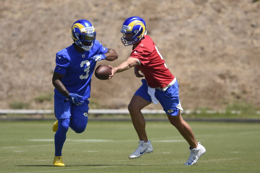 Rams quarterback Matthew Stafford hands off the football to Cam Akers during a drill in Thousand Oaks.