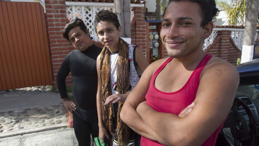 Jeffrey Hernandez and Fernando Galindo from Honduras and Wilbur Martinez from Guatemala spoke outside of a rented house in Playas de Tijuana where a group of LGBT individuals arrived Sunday, the first members of the Central American Caravan now in Tijuana.